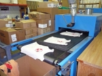 This machines dries the logos onto the shirts. These are not the ones we ordered, but they could be. Ours had already be