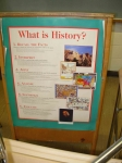 Identify the photos on this sign. Answers: Mount Rushmore, the Boston Massacre, the Indian wars, the Civil War, World Wa