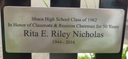 The plaque that is on the bench